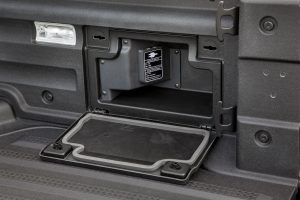 The 2017 Honda Ridgeline includes a 110-volt power outlet behind a panel in the right side of the bed. It's 400-watt output is enough to power a 55-inch television, for example.